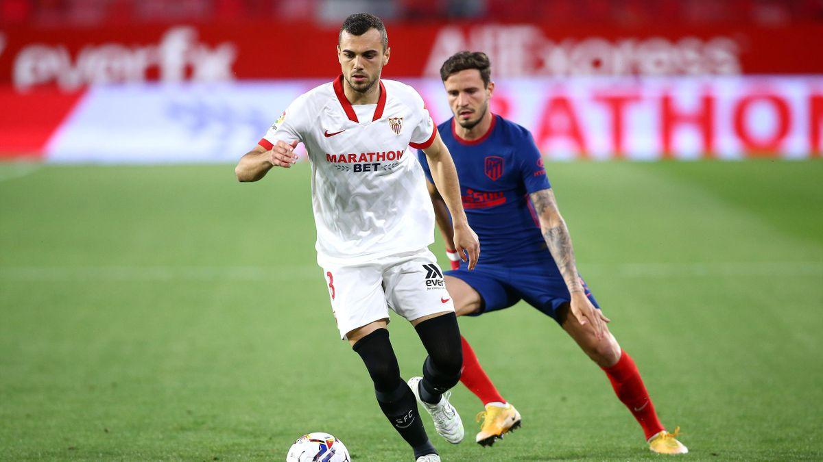 Joan Jordán (Sevilla) y Saúl Ñíguez (Atlético)