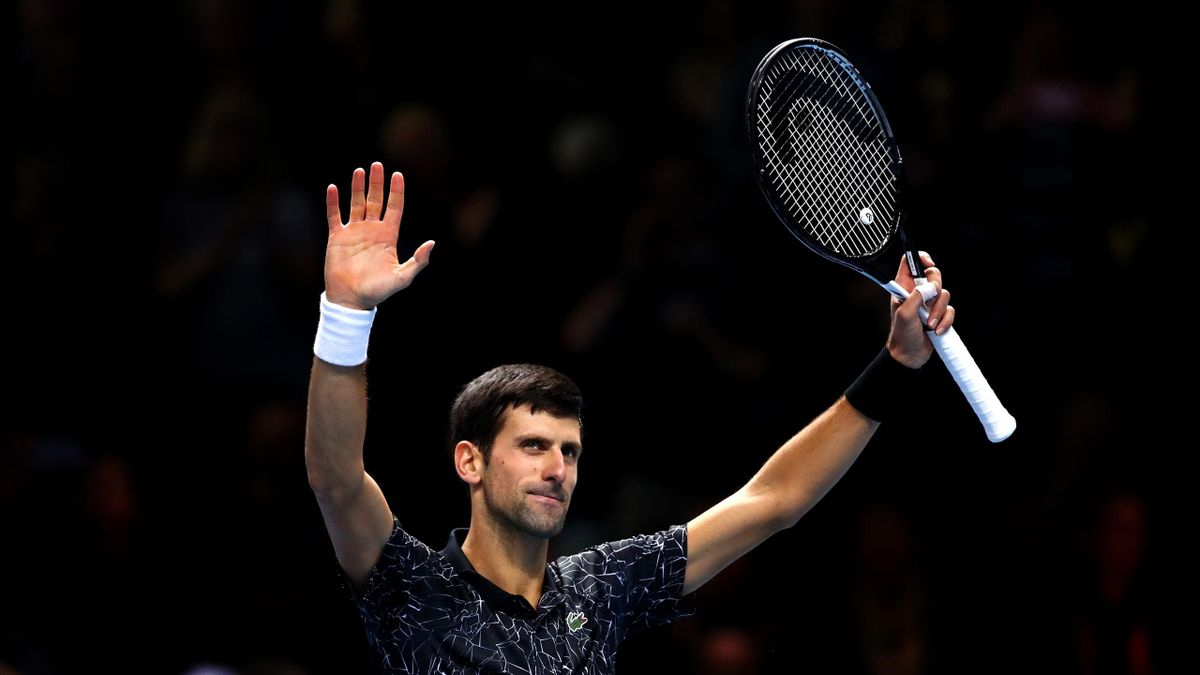 Alexander Zverev of Germany and Novak Djokovic of Serbia embrace after their singles round robin match during Day Four of the Nitto ATP Finals at The O2 Arena on November 14, 2018 in London, England