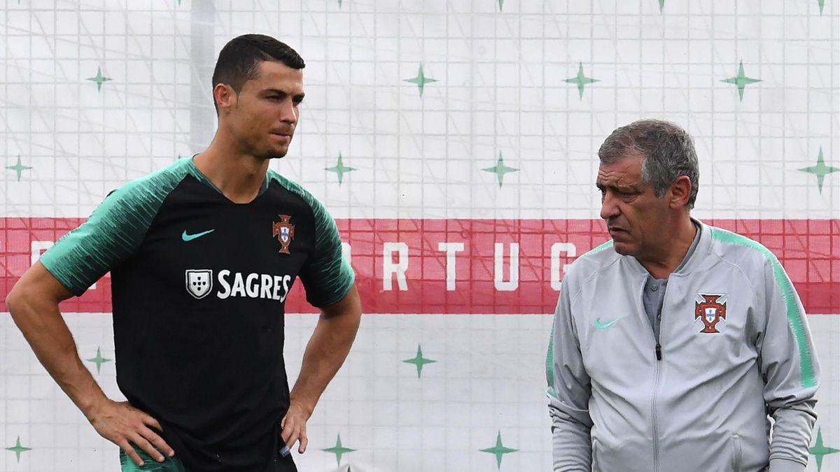 Portugal's forward Cristiano Ronaldo (L) talks to coach Fernando Santos
