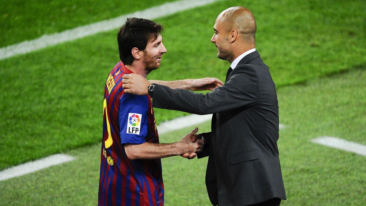 Lionel Messi of FC Barcelona and Josep Guardiola