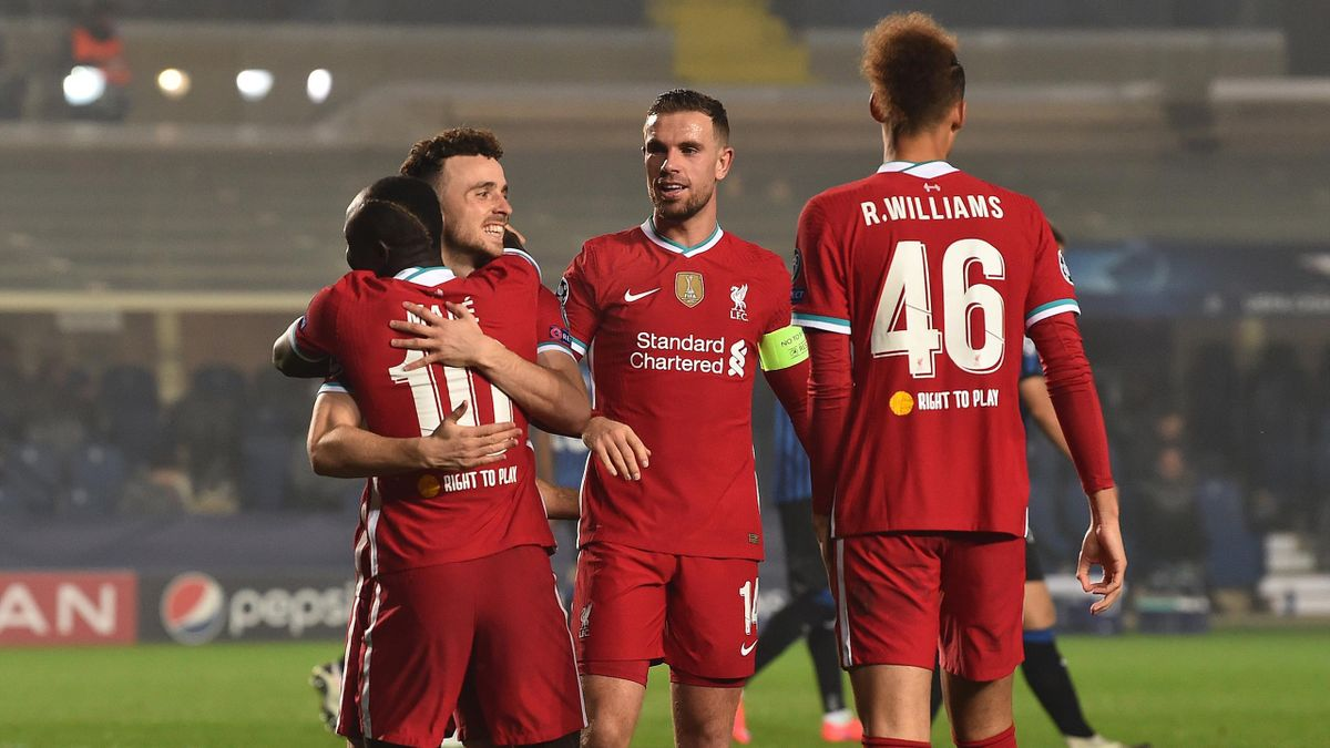 Liverpool's Portuguese striker Diogo Jota (L) is congratulated by teammates after scoring a goal during the UEFA Champions league football match Atalanta Bergamo vs Liverpool, on November 3, 2020 at the Atalanta stadium in Bergamo