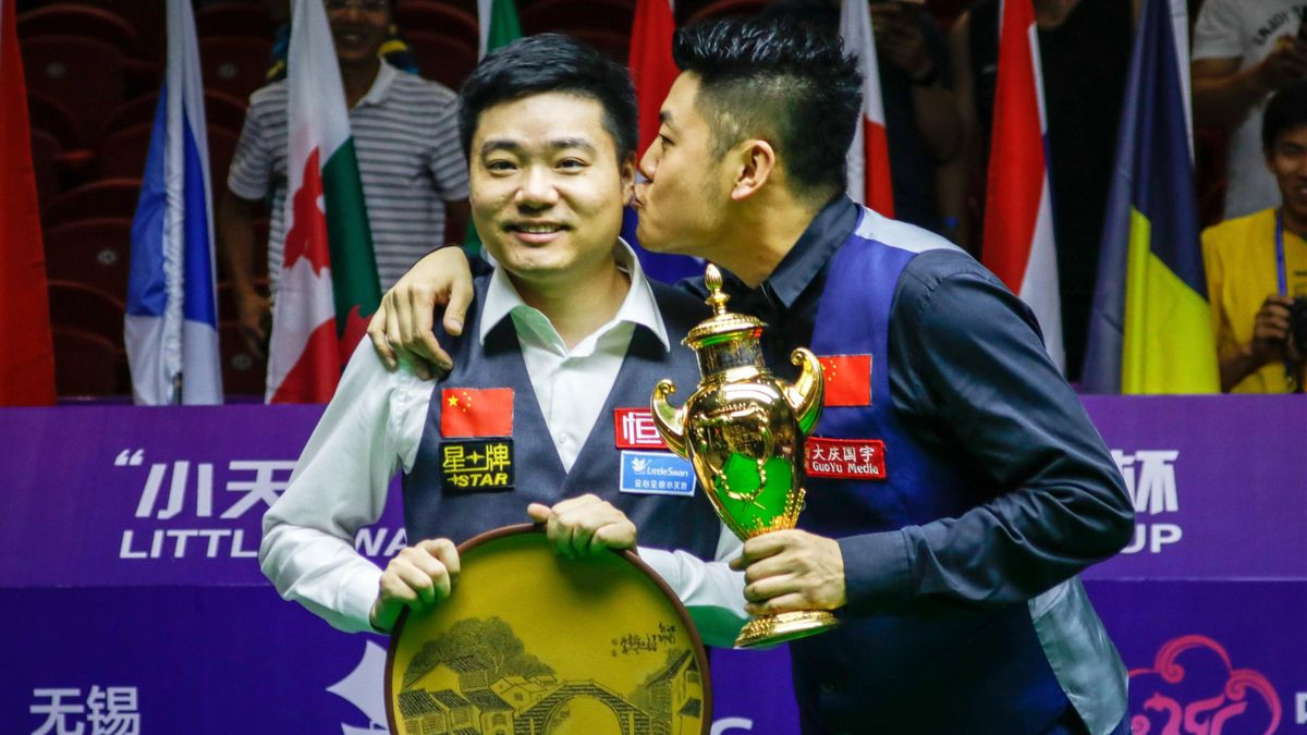 Ding Junhui and Liang Wenbo celebrate their World Cup win.