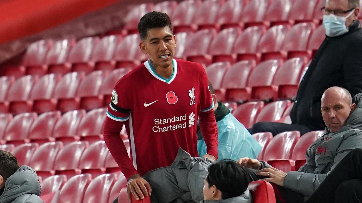 Roberto Firmino heading for the Liverpool subs bench
