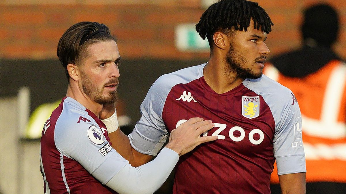 Jack Grealish (L) celebrates scoring the opening goal with Aston Villa's English defender Tyrone Mings during the English Premier League football match between Fulham and Aston Villa at Craven Cottage in London on September 28, 2020