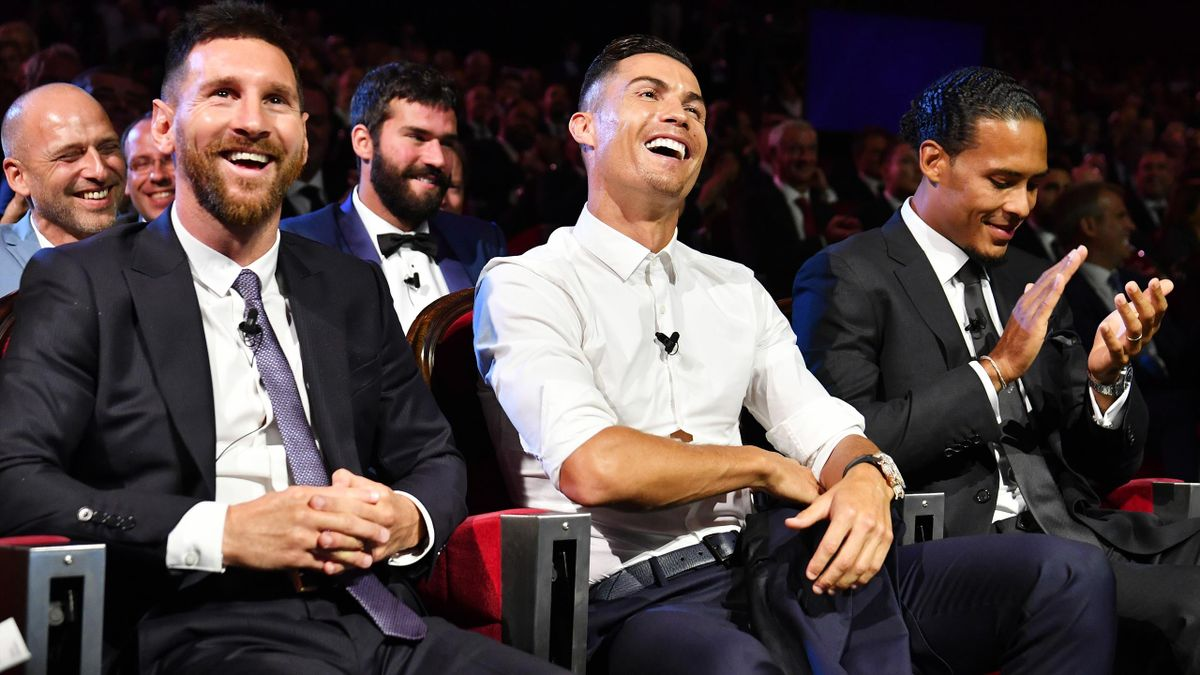 Lionel Messi and Cristiano Ronaldo share a joke at the Champions League draw