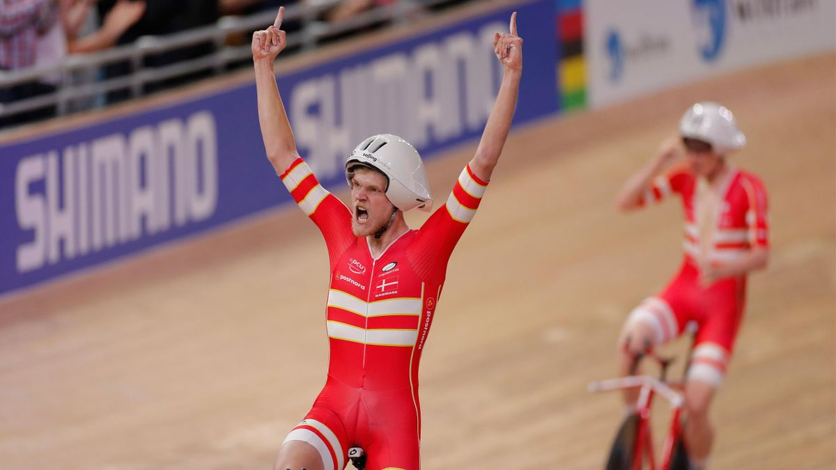 Denmark's Julius Johansen (L) and his teammates celebrate Gold and a new World Record in the men's Team Pursuit Finals at the UCI track cycling World Championship at the velodrome in Berlin on February 27, 2020. (Photo by Odd ANDERSEN / AFP) (Photo by ODD