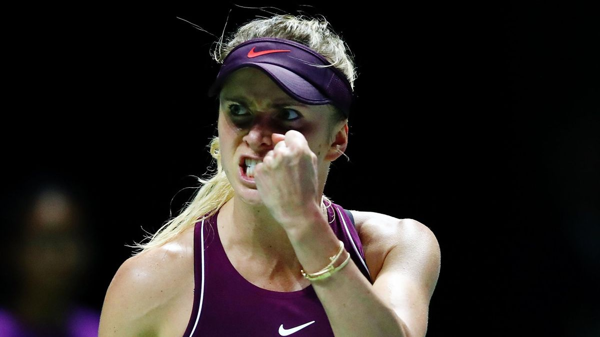 Elina Svitolina of the Ukraine reacts to set point in her singles match against Caroline Wozniacki of Denmark during day 5 of the BNP Paribas WTA Finals Singapore presented by SC Global at Singapore Sports Hub on October 25, 2018 in Singapore