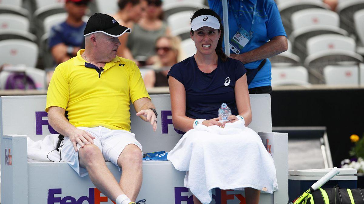 Johanna Konta of Great Britain speaks to her coach in her 1st round match against Agnieszka Radwanska