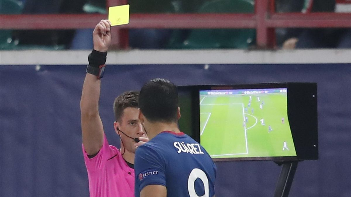 Luis Suarez was booked for trying to get a look at the VAR monitor