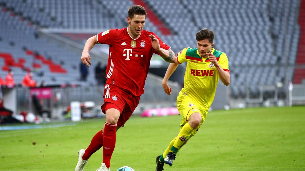 Niklas Süle (links; FC Bayern) im Spiel gegen den 1. FC Köln