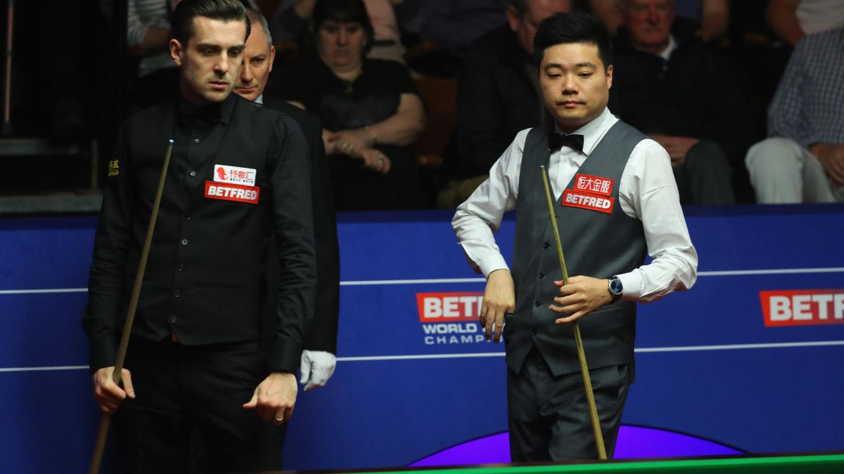Mark Selby of England and Ding Junhui of China looks on during their semi final match on day fifteen of Betfred World Championship 2017