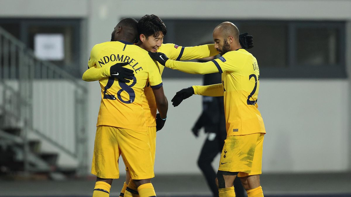 Son Heung-Min of Tottenham Hotspur celebrates with Tanguy NDombele and Lucas Moura