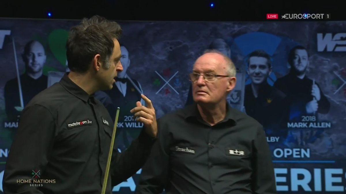 Ronnie O'Sullivan speaks to the referee during the Scottish Open final