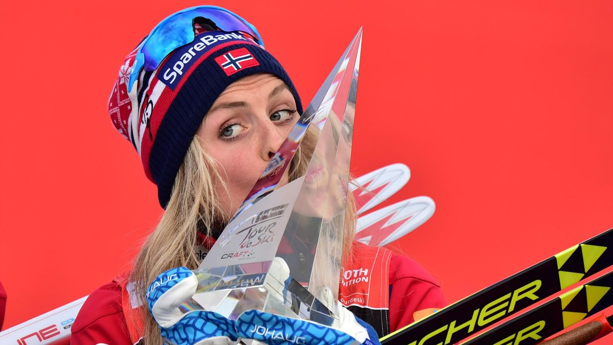 Norway's Therese Johaug kisses her trophy on the podium after winning the Women's 9 km Climb Pursuit of the FIS World Cup Tour de Ski at Cermis' Alpes in Cavalese