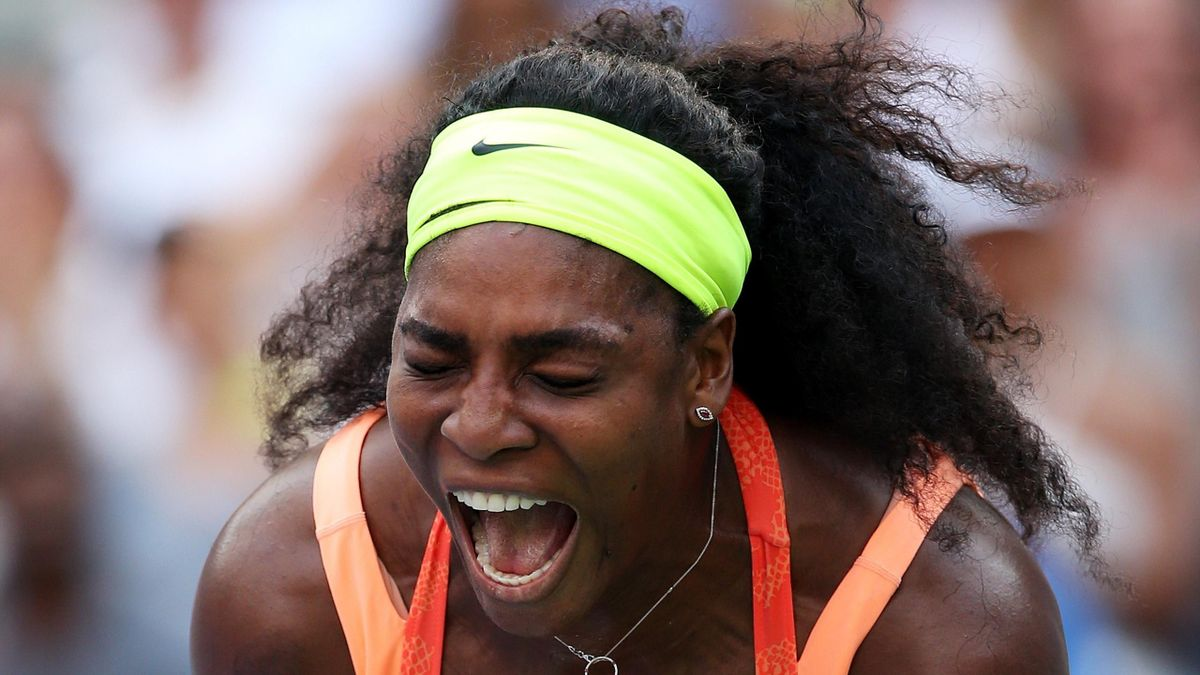 Serena Williams of the United States reacts after winning the first set of her Women's Singles Second Round match against Kiki Bertens of the Netherlands on Day Three of the 2015 US Open at the USTA Billie Jean King National Tennis Center on September 2,
