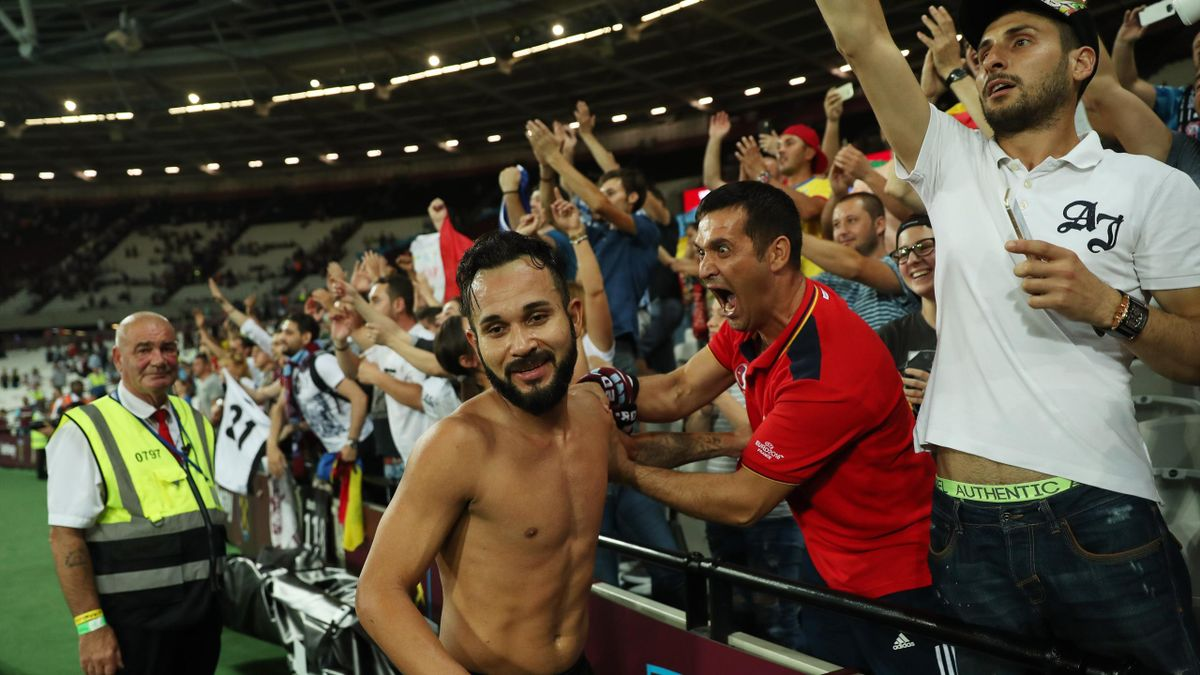 FC Astra Giurgiu's Junior Morais celebrates with their fans after the match
