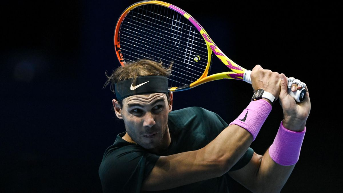 Rafael Nadal of Spain hits a backhand against Stefanos Tsitsipas of Greece during Day 5 of the Nitto ATP World Tour Finals at The O2 Arena on November 19, 2020 in London, England