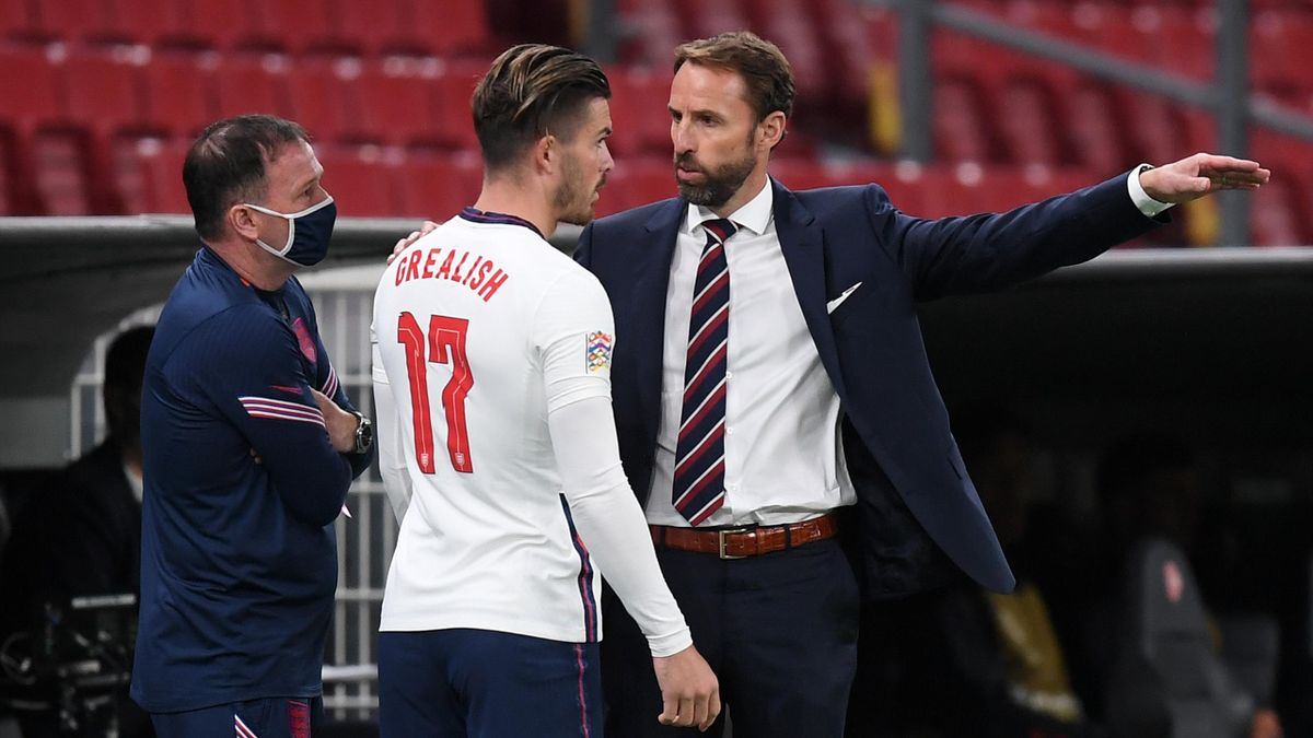 Gareth Southgate, Manager of England gives instructions to Jack Grealish of England prior to him being substituted onto the pitch during the UEFA Nations League group stage match between Denmark and England at Parken Stadium on September 08, 2020 in Copen