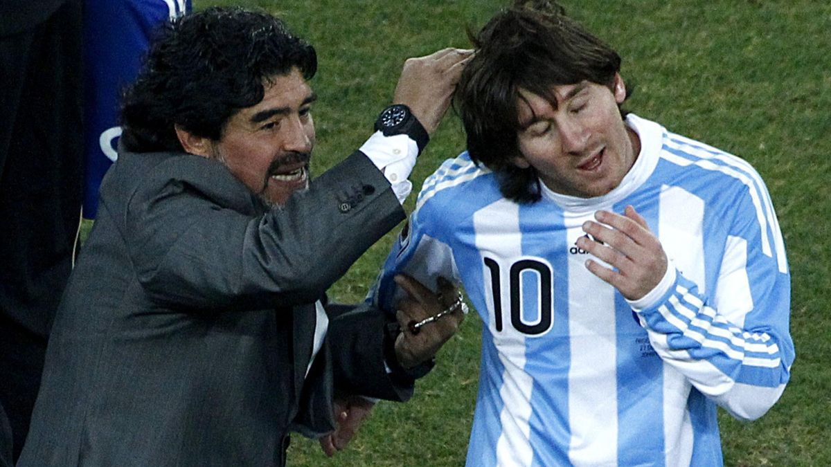 Diego Maradona celebrates with Argentina's Lionel Messi after their 2010 World Cup second round soccer match against Mexico