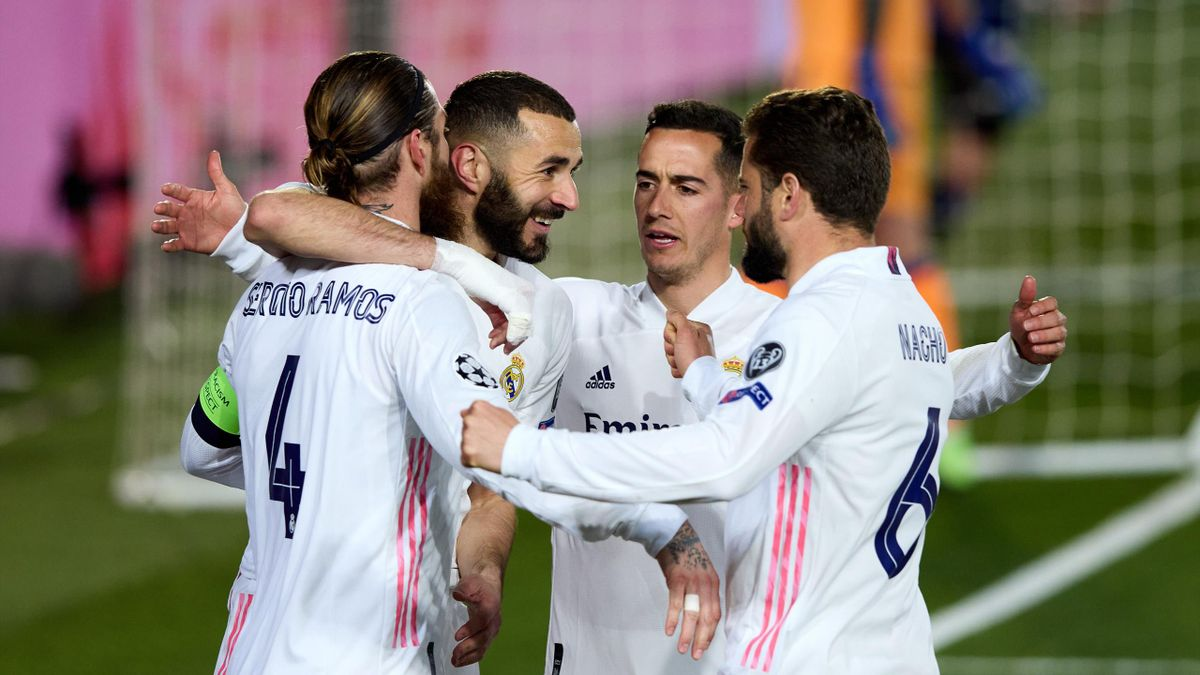 Sergio Ramos of Real Madrid celebrates with team mates after scoring their side's second during the UEFA Champions League Round of 16 match between Real Madrid and Atalanta at Estadio Alfredo Di Stefano on March 16, 2021 in Madrid, Spain.