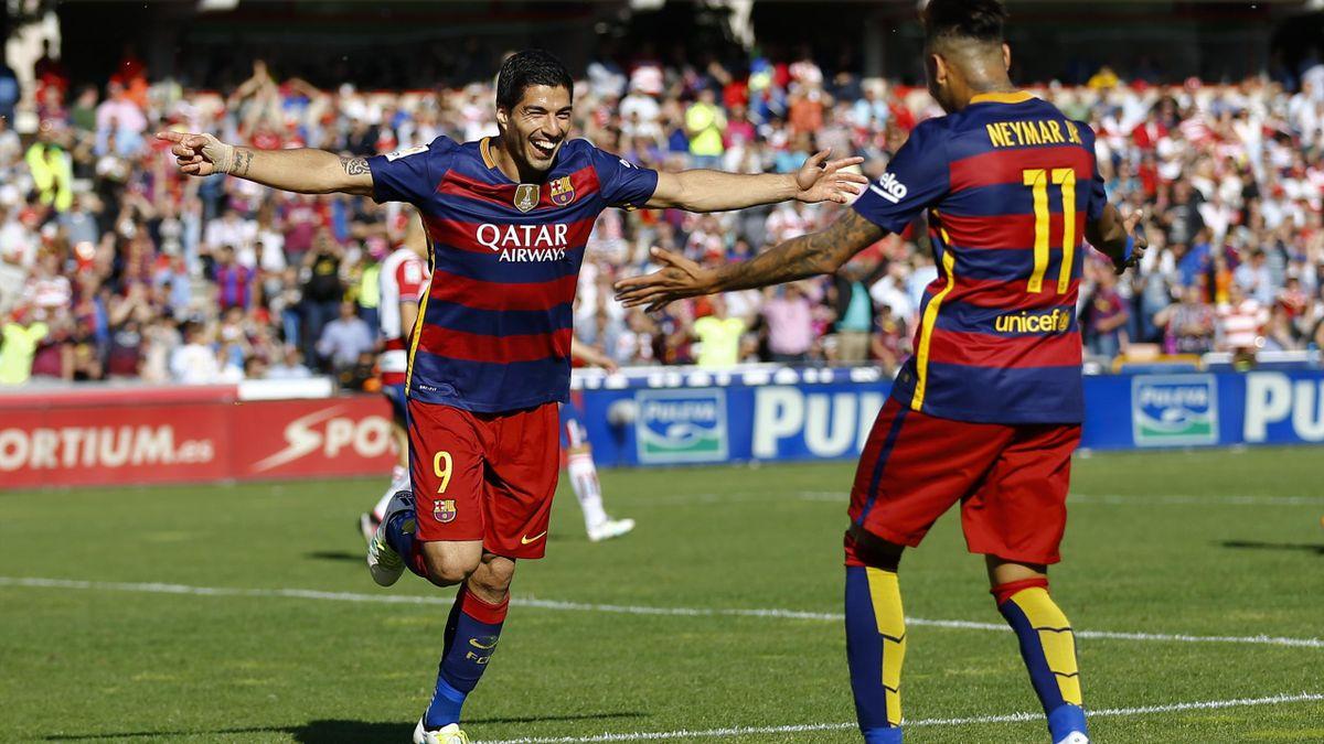 Barcelona's Luis Suarez (L) celebrates his third goal with team mate Neymar.