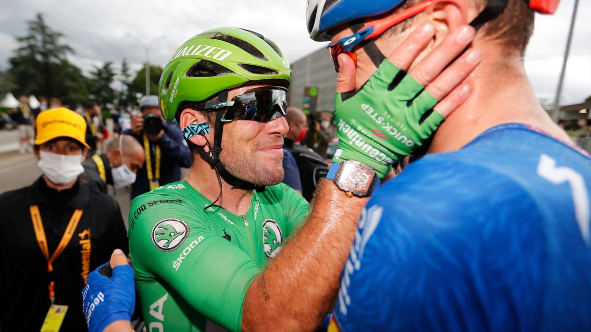 Team Deceuninck Quickstep's Mark Cavendish (L) of Great Britain wearing the best sprinter's green jersey celebrates after winning the 10th stage of the 108th edition of the Tour de France cycling race, 190 km between Albertville and Valence, on July 06