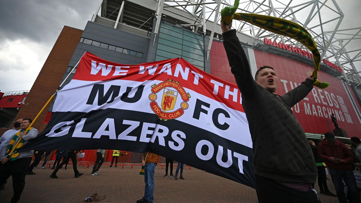 Supporters protest against Manchester United's owners, outside English Premier League club Manchester United's Old Trafford stadium in Manchester, north west England on May 2, 2021