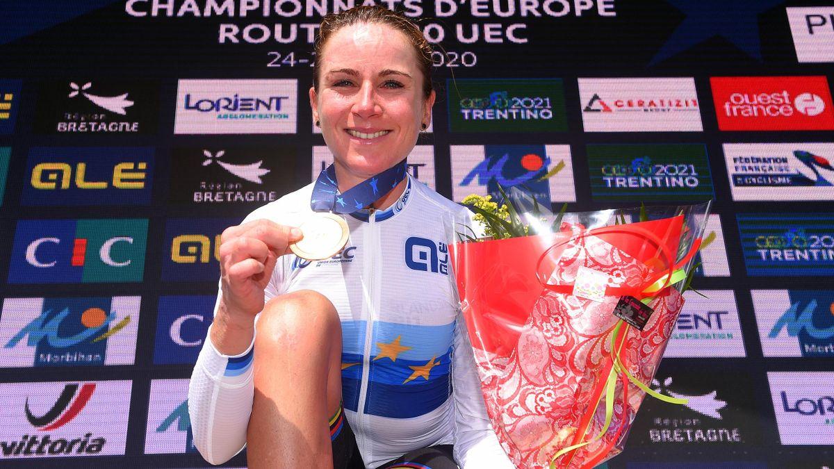 Annemiek van Vleuten celebrates winning the women's road race at the European Championships