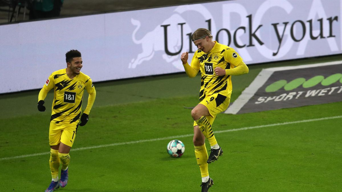 Erling Haaland of Borussia Dortmund celebrates with teammate Jadon Sancho after scoring their sides second goal during the Bundesliga match between RB Leipzig and Borussia Dortmund at Red Bull Arena on January 09, 2021 in Leipzig, Germany