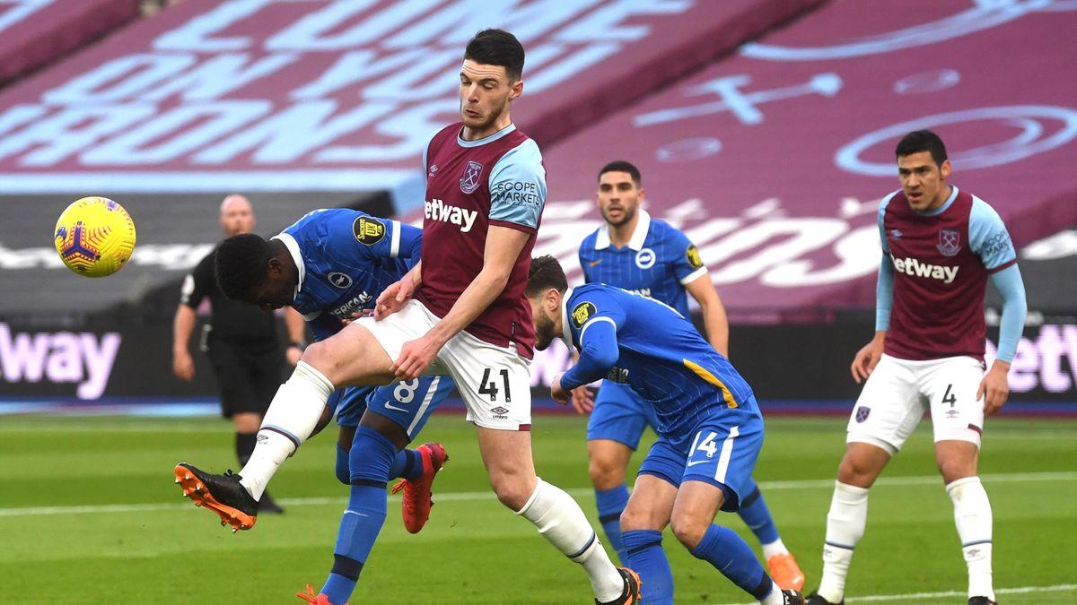 West Ham United's English midfielder Declan Rice (2L) beats Brighton's Ivorian midfielder Yves Bissouma