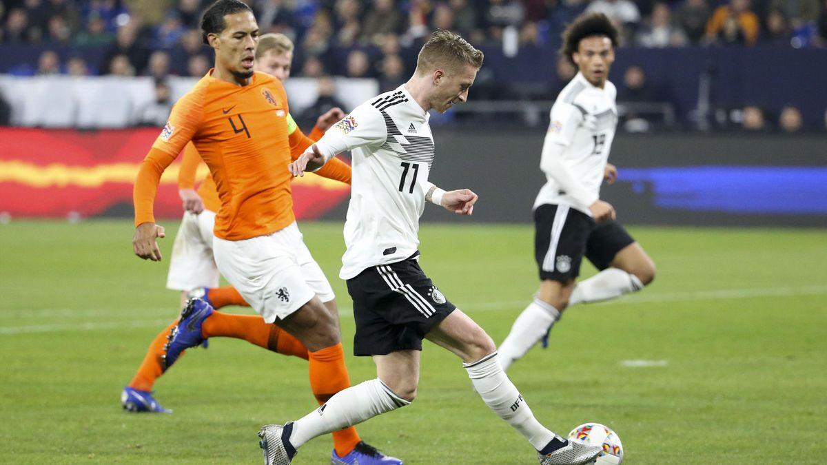 Вирджил ван Дейк и Марко Ройс в матче Германия – Нидерланды