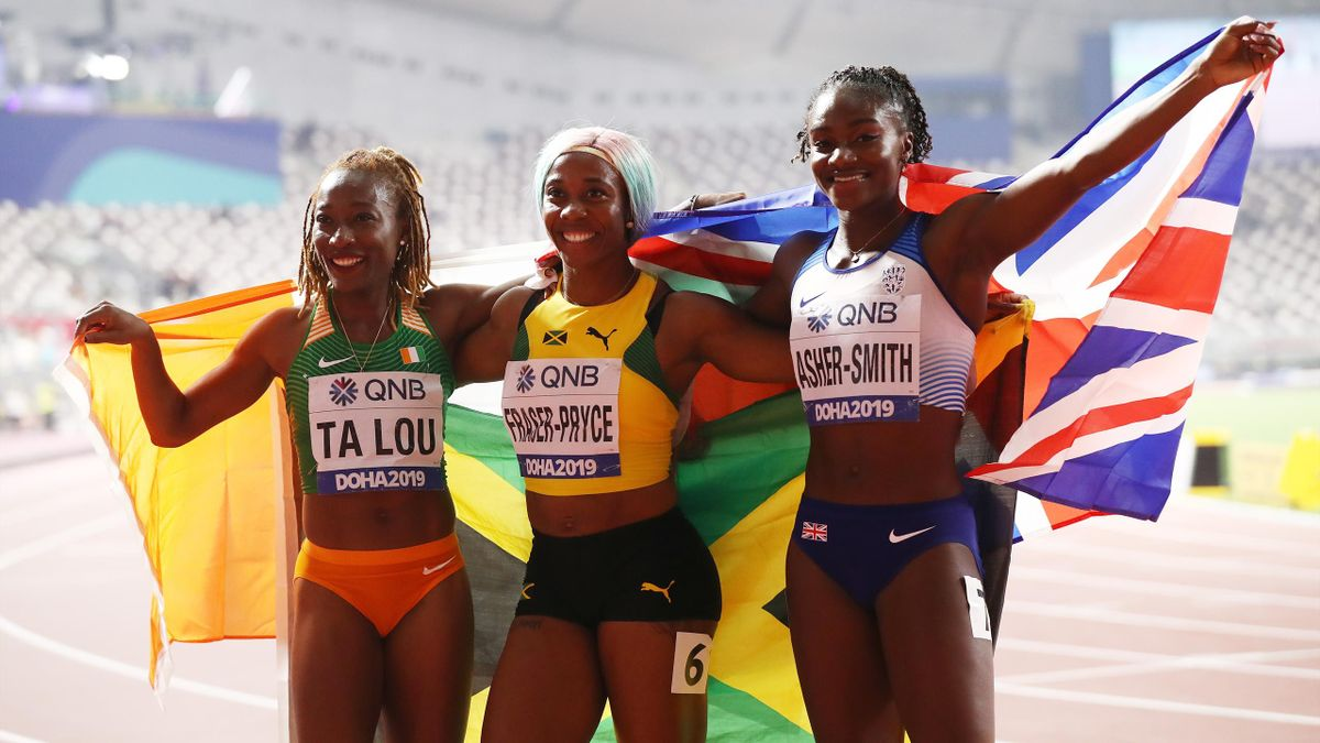 Shelly-Ann Fraser-Pryce of Jamaica, gold, Dina Asher-Smith of Great Britain, silver, and Marie-Josée Ta Lou of the Ivory Coast, bronze, celebrate