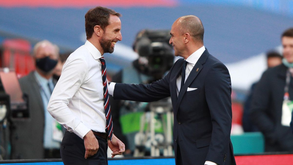 England's manager Gareth Southgate (L) greets Belgium's coach Roberto Martinez before the UEFA Nations League group A2 football match between England and Belgium at Wembley stadium in north London on October 11, 2020.