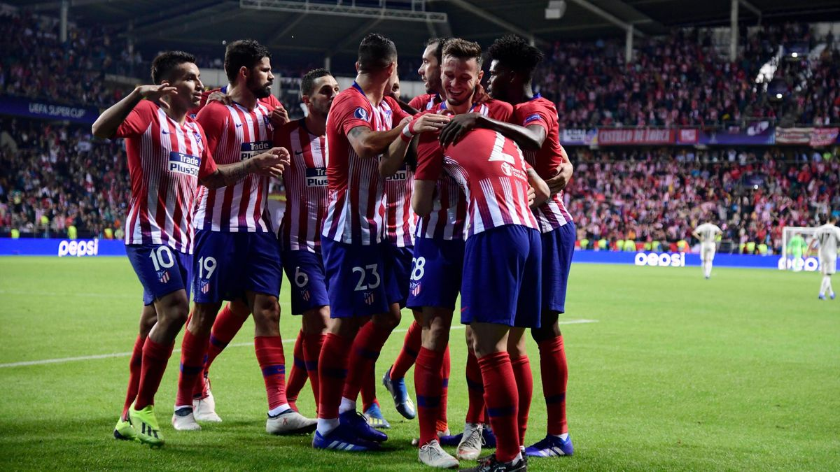 Atletico Madrid's Spanish midfielder Saul Niguez (2ndR) celebrates with teammates after scoring a goal during the UEFA Super Cup football match between Real Madrid and Atletico Madrid at the Lillekula Stadium in the Estonian capital Tallinn on August 15,