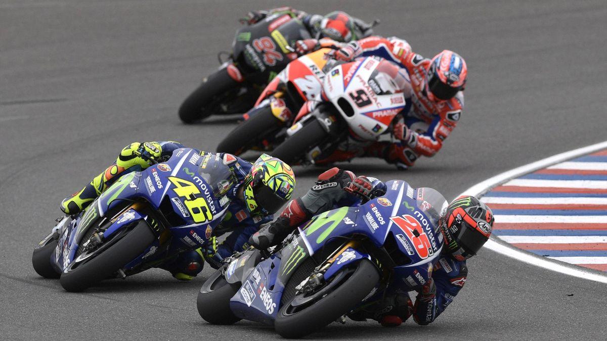 Spanish biker Maverick Vinales (25), rides his Yamaha next to Italian Valentino Rossi (46), during the MotoGP race of the Argentina Grand Prix