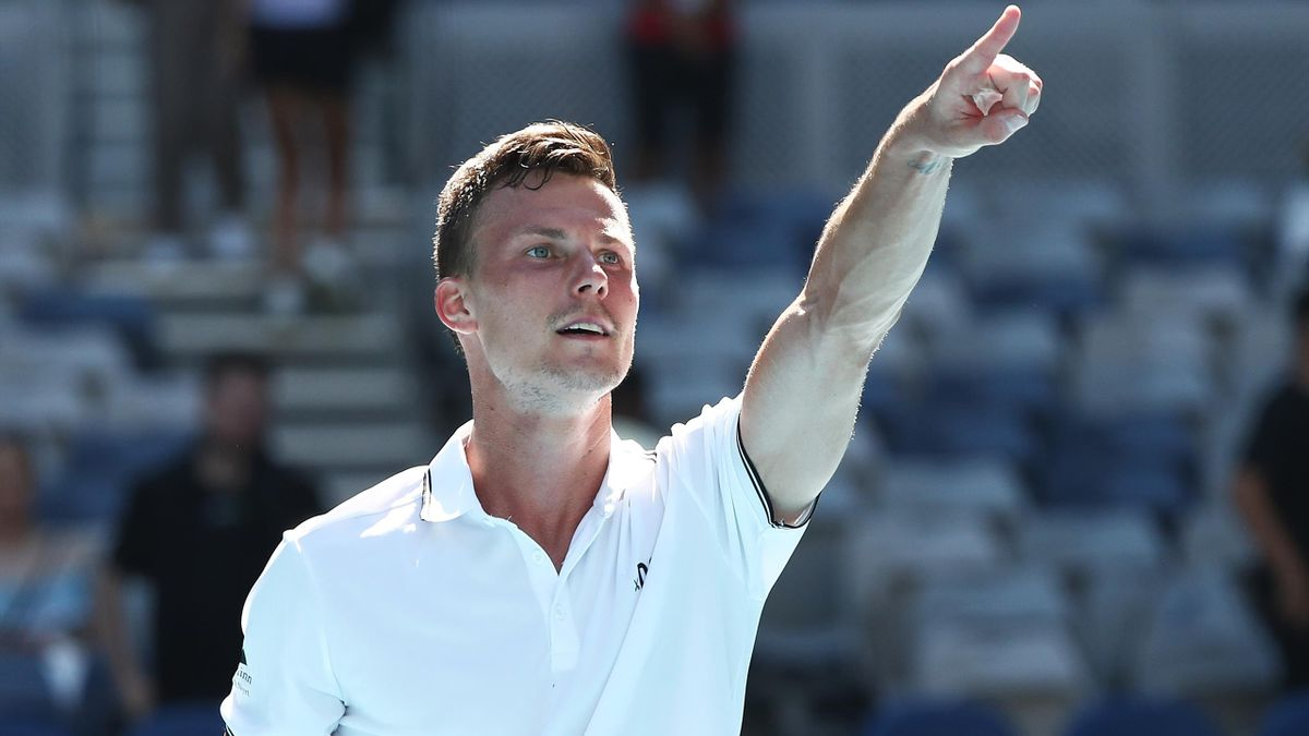Marton Fucsovics of Hungary celebrates winning match point in his Men's Singles second round match against Stan Wawrinka of Switzerland during day three of the 2021 Australian Open at Melbourne Park