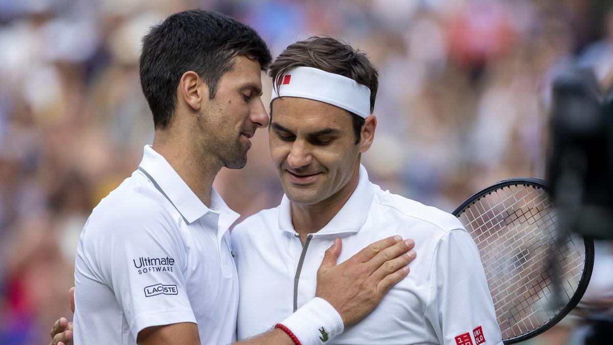 Novak Djokovic (SER) speaks with Roger Federer (SUI)