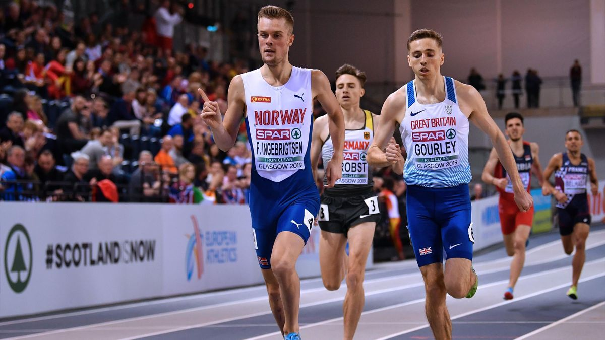 Norway's Filip Ingebrigtsen (L) reacts as he crosses the line ahead of Britain's Neil Gourley to win the mens 1500m qualifier event at the 2019 European Athletics Indoor Championships in Glasgow