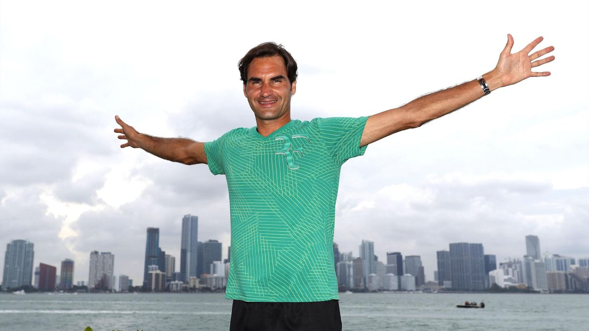 Roger Federer poses in front of the Miami skyline.