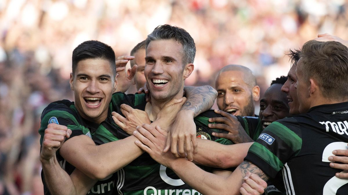 Feynoord's Robin van Persie (C) celebrates with teammates after scoring during the Dutch Cup soccer final between Feyenoord Rotterdam and AZ Alkmaar at The Kuip Stadium in Rotterdam, The Netherlands on April 22, 2018.