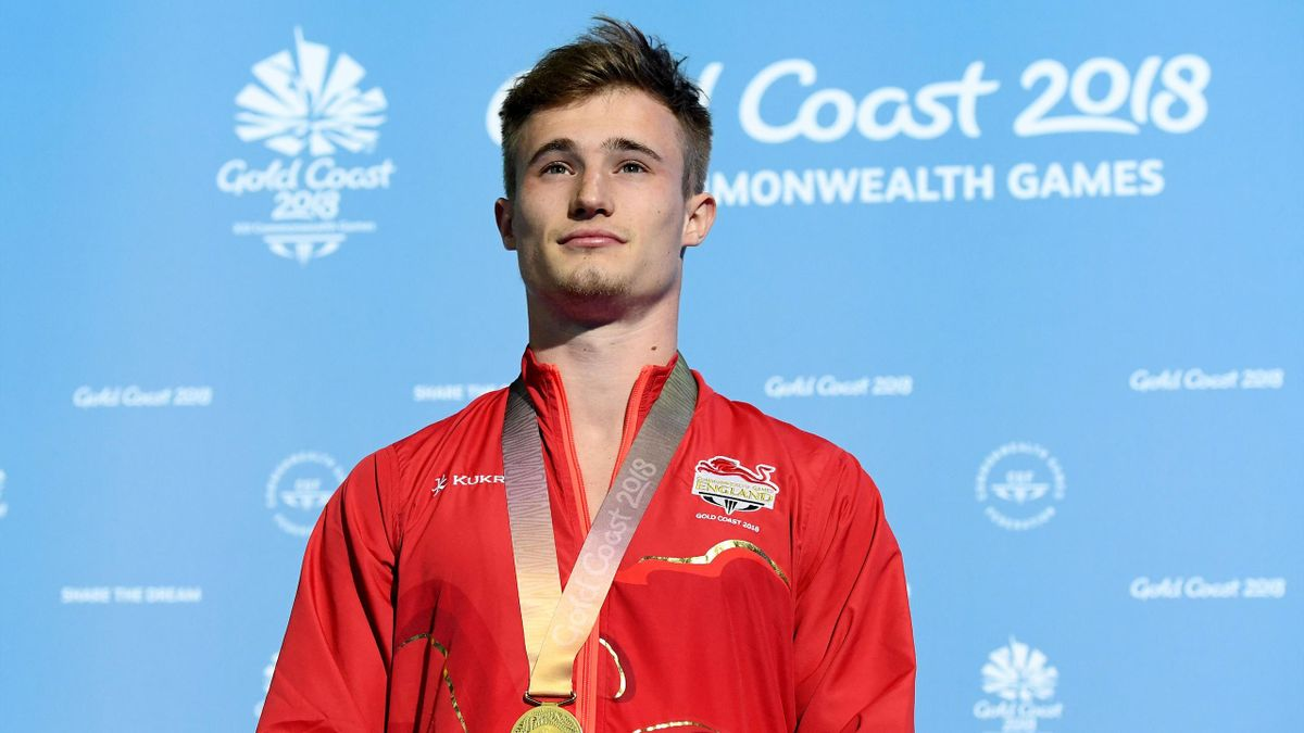 Gold medalist Jack Laugher of England poses during the medal ceremony for the Men's 1m Springboard Diving Final on day seven of the Gold Coast 2018 Commonwealth Games at Optus Aquatic Centre