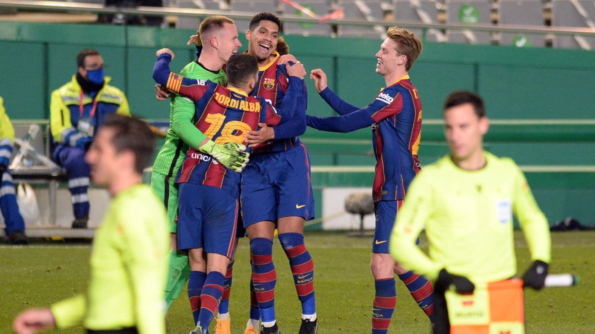 Barcelona players celebrate their victory after the penalty shoot-out in Spanish Super Cup semi final football match between Real Sociedad and FC Barcelona at the Nuevo Arcangel stadium