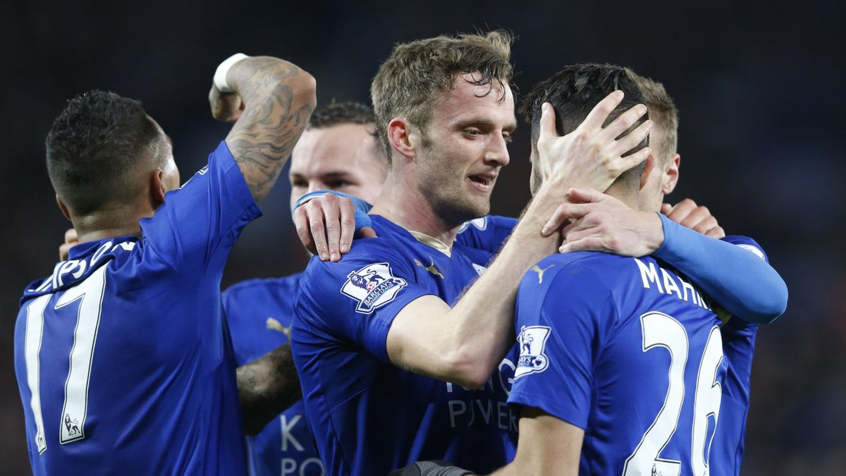 Andy King celebrates with Riyad Mahrez and team mates after scoring the second goal for Leicester City