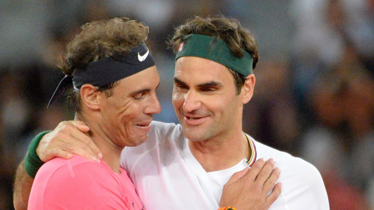 Switzerland's Roger Federer (R) hugs Spain's Rafael Nadal (L) during their tennis match at The Match in Africa at the Cape Town Stadium, in Cape Town on February 7, 2020.