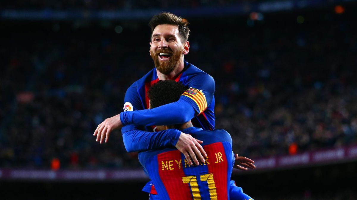 Neymar of Barcelona celebrates with Lionel Messi