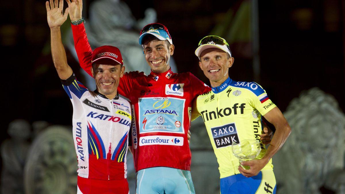"Winner Astana's Italian cyclist Fabio Aru (C), second Katusha's Spanish cyclist Joaquin Rodriguez (L) and third-placed Tinkoff Saxo's Polish cyclist Rafal Majka celebrate on the podium of the 70th edition of ""La Vuelta"" Tour of Spain in Madrid on Septembe"