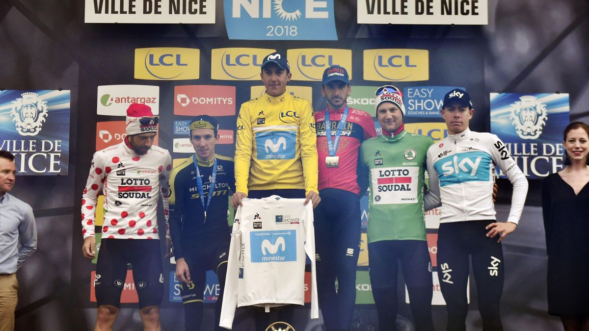 Paris-Nice 2018 winner Spain's Marc Soler (3rdL) celebrates his overall leader yellow jersey and his best young's white jersey, second-placed Great Britain's Simon Yates (2ndL), third-placed Spain's Gorka Izagirre (3rdR).