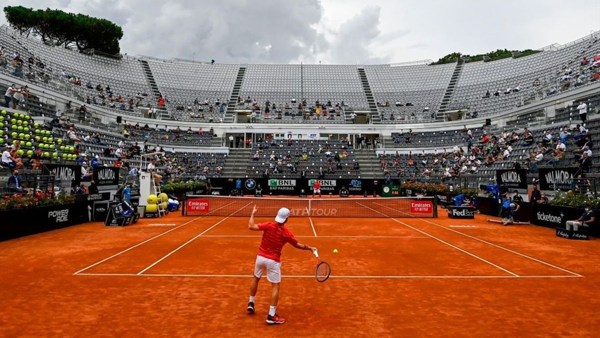 Diego Schwartzman (Front) plays a forehand to Serbia's Novak Djokovic during the final match of the Men's Italian Open at Foro Italico on September 21, 2020