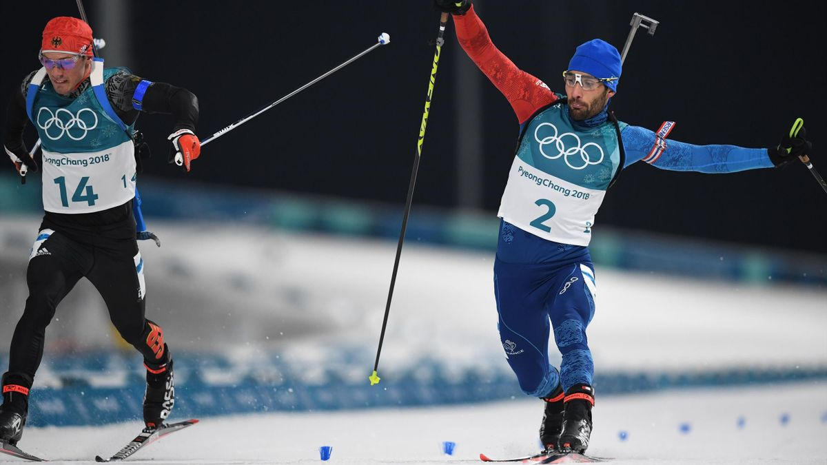 Martin Fourcade sacré champion olympique de la mass start en battant au sprint Simon Schempp à la photo-finish