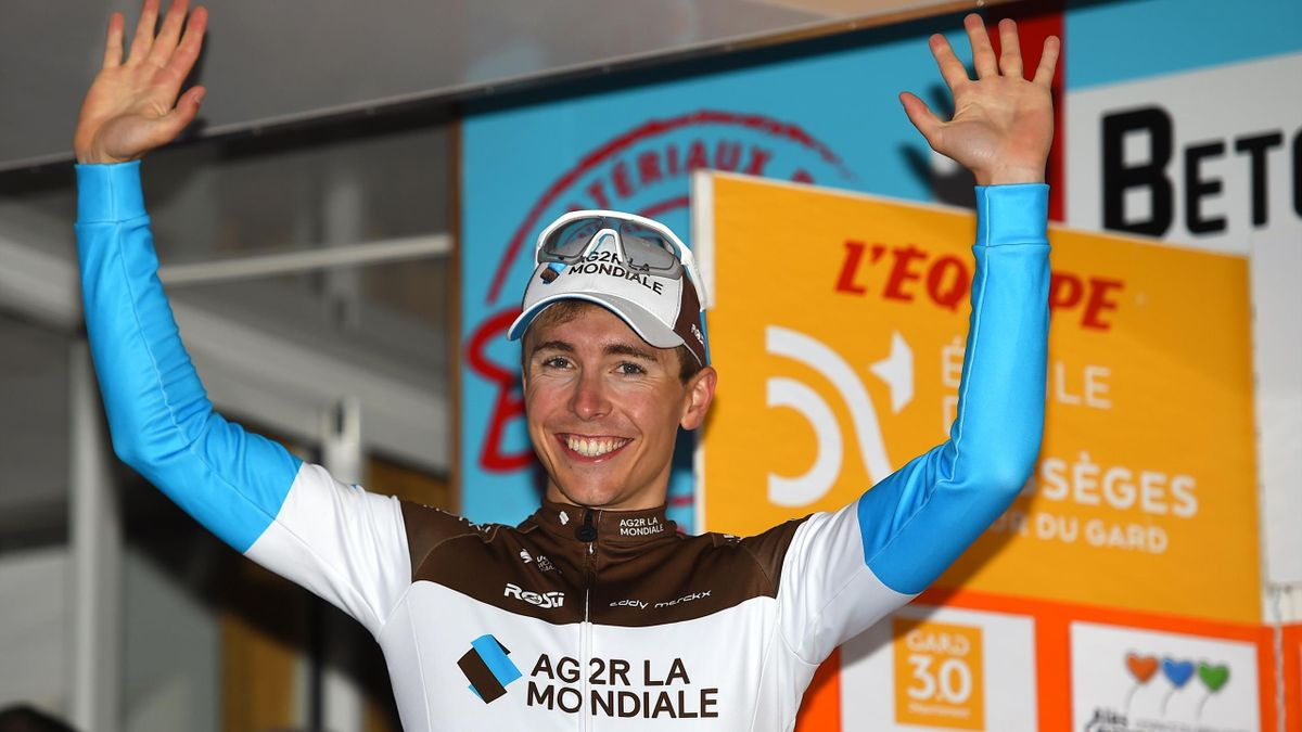 French cyclist Benoit Cosnefroy celebrates on the podium after the fifth and last stage to win the overall ranking in the 50th edition of the Etoile de Besseges cycling race, on February 9, 2020 in Alès, southern France